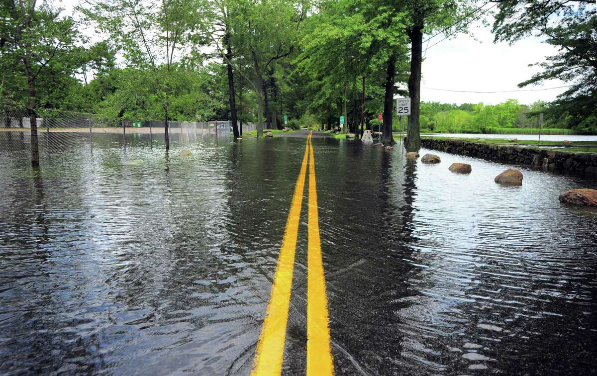 A view of a flooded Harding Road in Greenwich, Conn., on Friday July 9, 2021. Hurricane Isaias hit the region overnight and into this morning, causing severe flooding throughout the region.