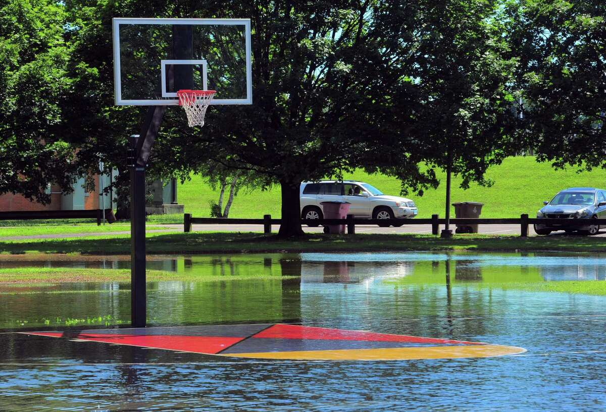 The basketball court remains flooded at Cummings Park in Stamford, Conn., on Friday July 9, 2021. Hurricane Isaias hit the region overnight and into this morning, causing severe flooding throughout the region.