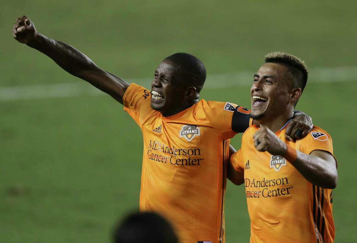 Houston Dynamo midfielder Darwin Ceren, right, celebrates his goal with penalty kick with Boniek Garcia (27) during the second half of a MLS match Wednesday, Oct. 7, 2020, at BBVA Stadium in Houston. Houston Dynamo defeated FC Dallas 2-0.