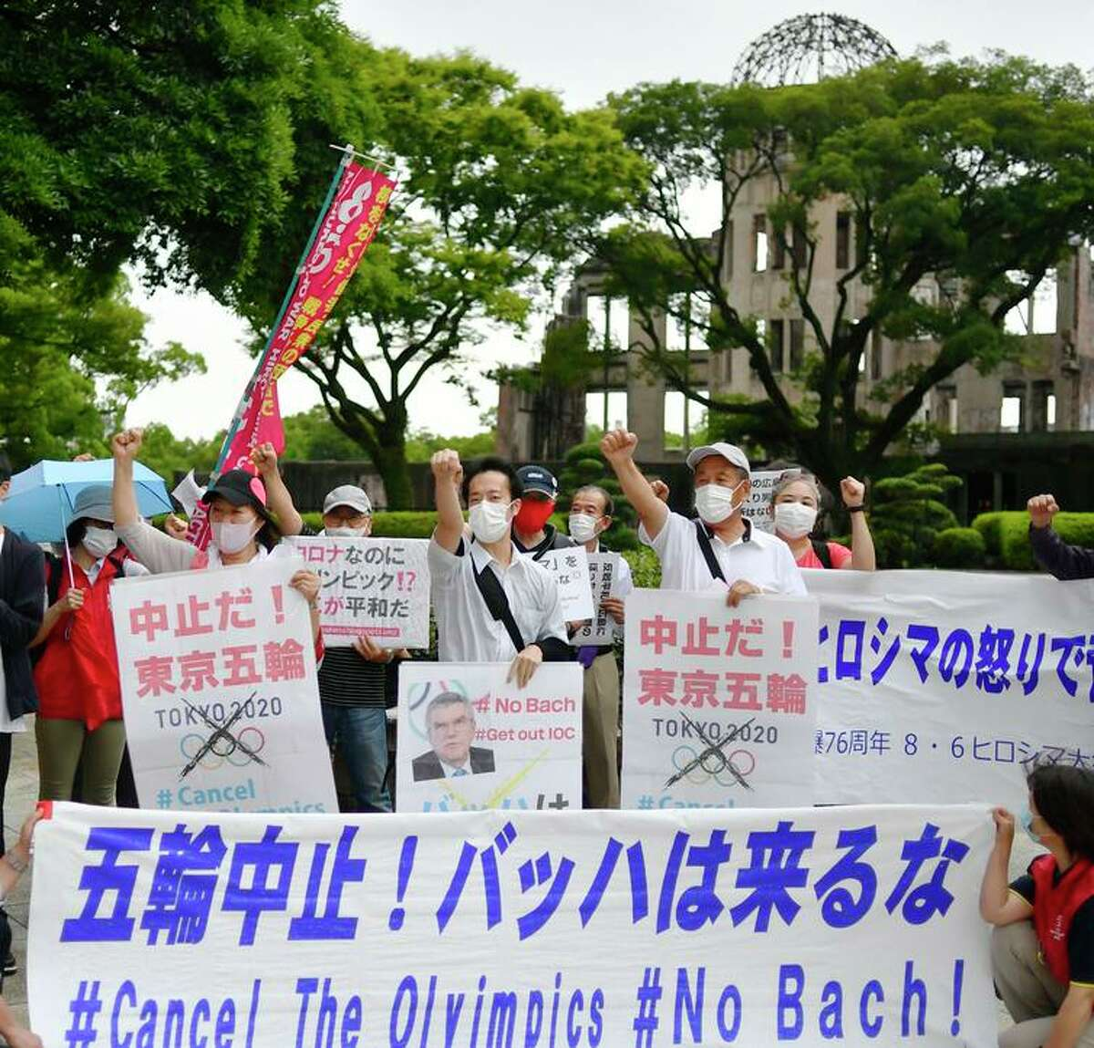 Protesters gather near the Atomic Bomb Dome with a message for IOC President Thomas Bach.