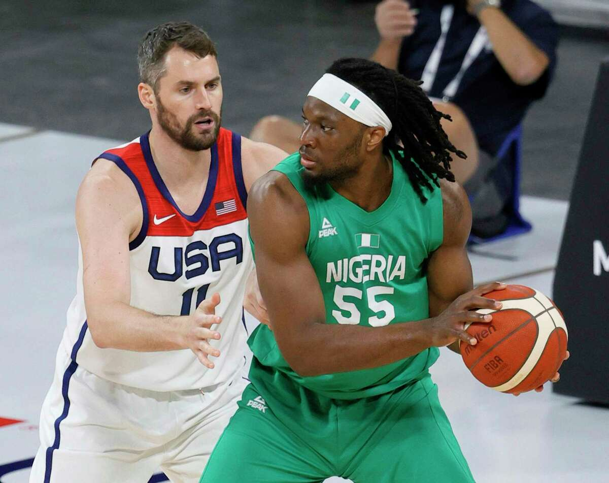 Precious Achiuwa (55) of Nigeria is guarded by Kevin Love #11 of the United States during an exhibition game at Michelob ULTRA Arena ahead of the Tokyo Olympic Games on July 10, 2021 in Las Vegas, Nevada. Nigeria defeated the United States 90-87. (Ethan Miller/Getty Images/TNS)