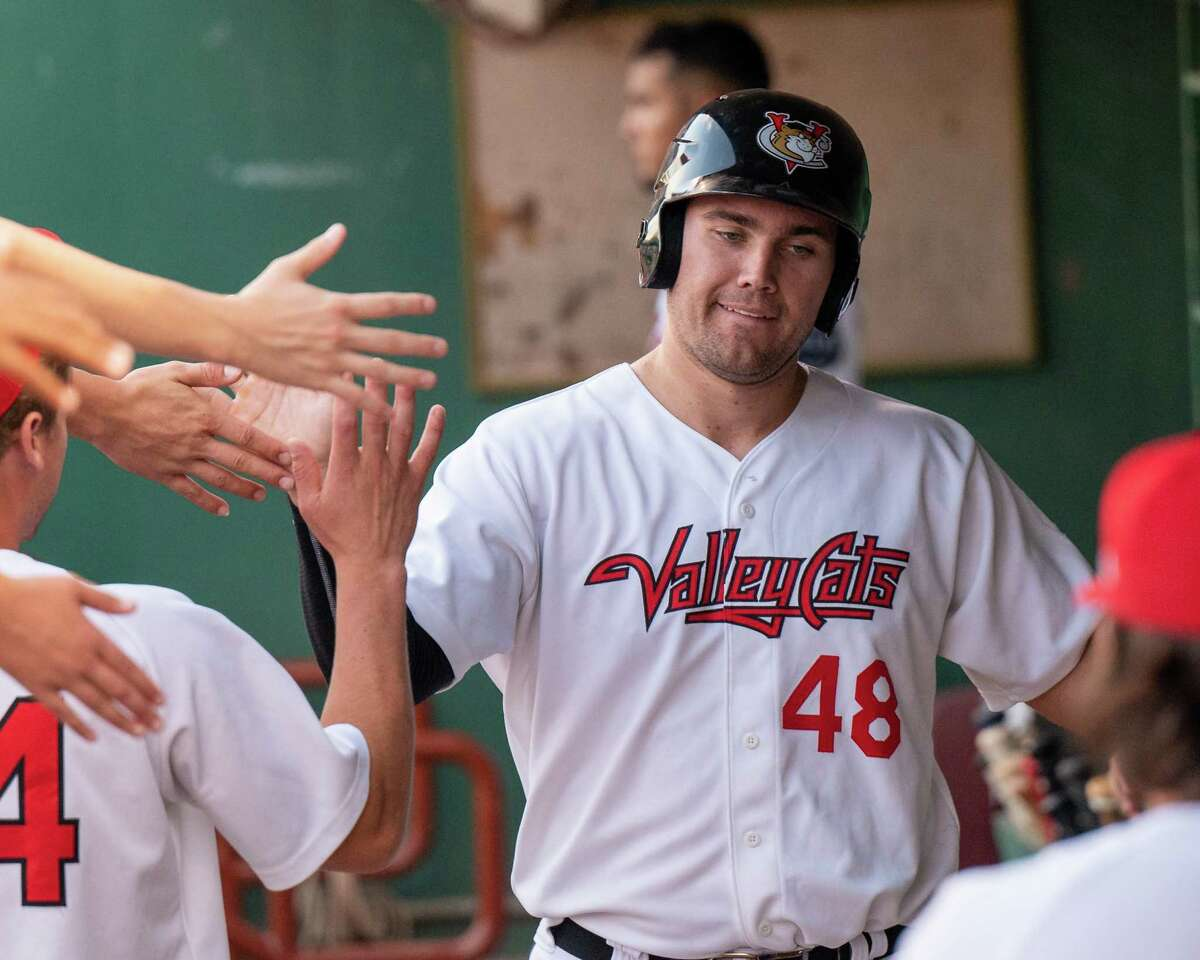 Tri-City ValleyCats first baseman Brad Zonica is congratulated after scoring a run against Equipe Quebec at Joseph L. Bruno Stadium on the Hudson Valley Community College campus in Troy, NY, on Friday, July 18, 2021. (Jim Franco/Special to the Times Union)