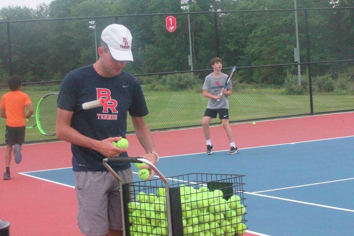 Big Rapids tennis coach Austin Brinker gets ready for a summer practice. (Pioneer photo/John Raffel)