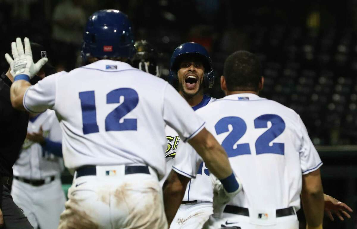 Sugar Land Skeeters infielder Yadiel Rivera (19) celebrates as he scores the winning run on a single by outfielder Bryan De La Cruz (16) during the ninth inning of a minor league baseball game Friday, May 21, at Constellation Field in Sugar Land.