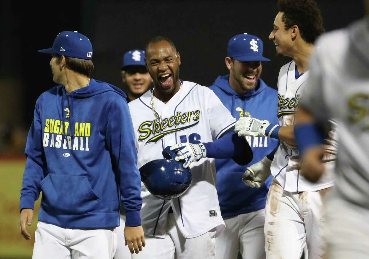 Sugar Land Skeeters outfielder Bryan De La Cruz (16) celebrates with teammates after he hit a single that brought in infielder Yadiel Rivera (19) to win the game against the El Paso Chihuahuas on Friday, May 21, at Constellation Field in Sugar Land.