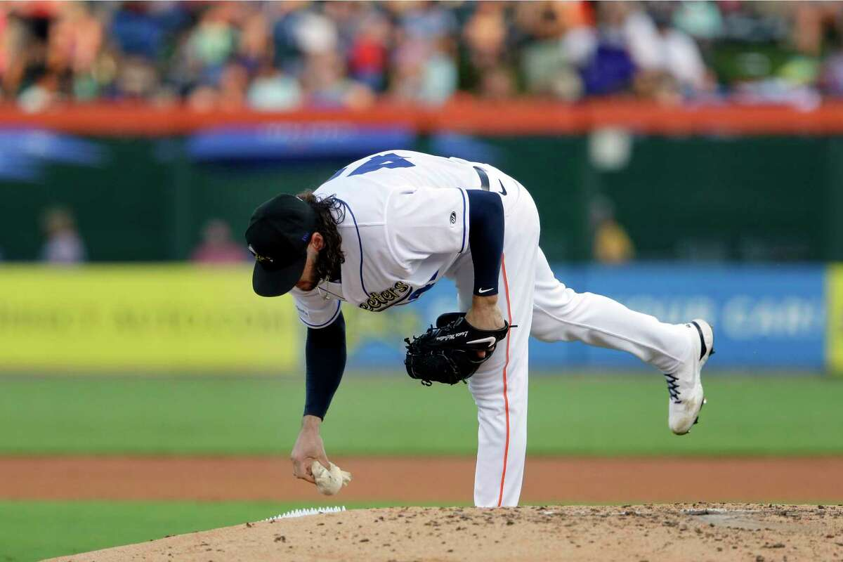 Lance McCullers grabs a rosin bag behind the mound as he pitches in the fourth inning against the Round Rock Express during a baseball game Thursday, June 10, in Houston.