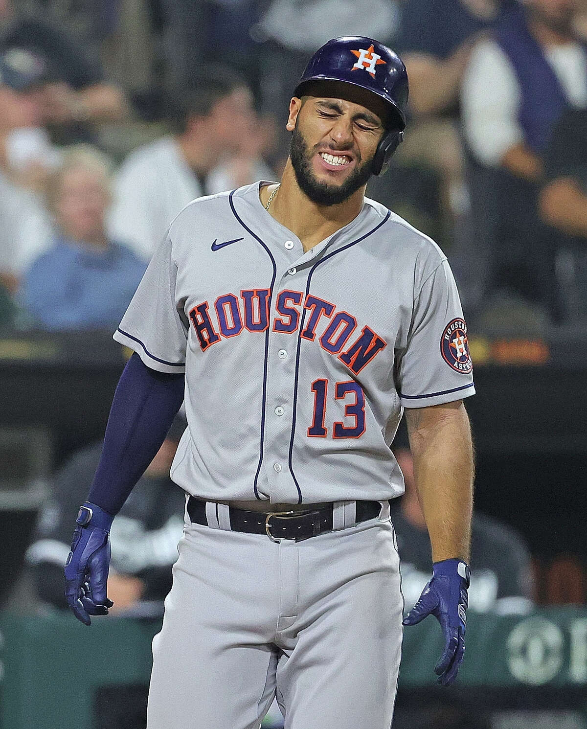 CHICAGO, ILLINOIS - JULY 16: Abraham Toro #13 of the Houston Astros reacts after being hit by a pitch in the 7th inning against the Chicago White Sox at Guaranteed Rate Field on July 16, 2021 in Chicago, Illinois. (Photo by Jonathan Daniel/Getty Images)