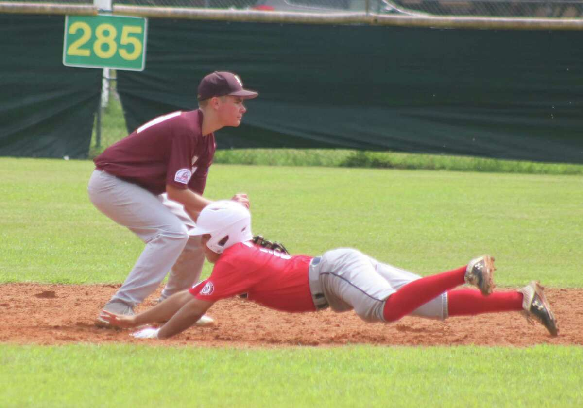Deer Park 13s all-star Rome Gatlin tries to snag a low throw as an Alamo City runner begins his dive into the second-base bag, avoiding being tagged out in a rundown during the South Zone Tournament,.