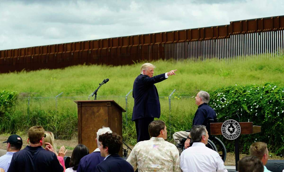 Former President Donald Trump, left, and Texas Gov. Greg Abbott, right, visit an unfinished section of border wall, in Pharr, Texas, Wednesday, June 30, 2021.