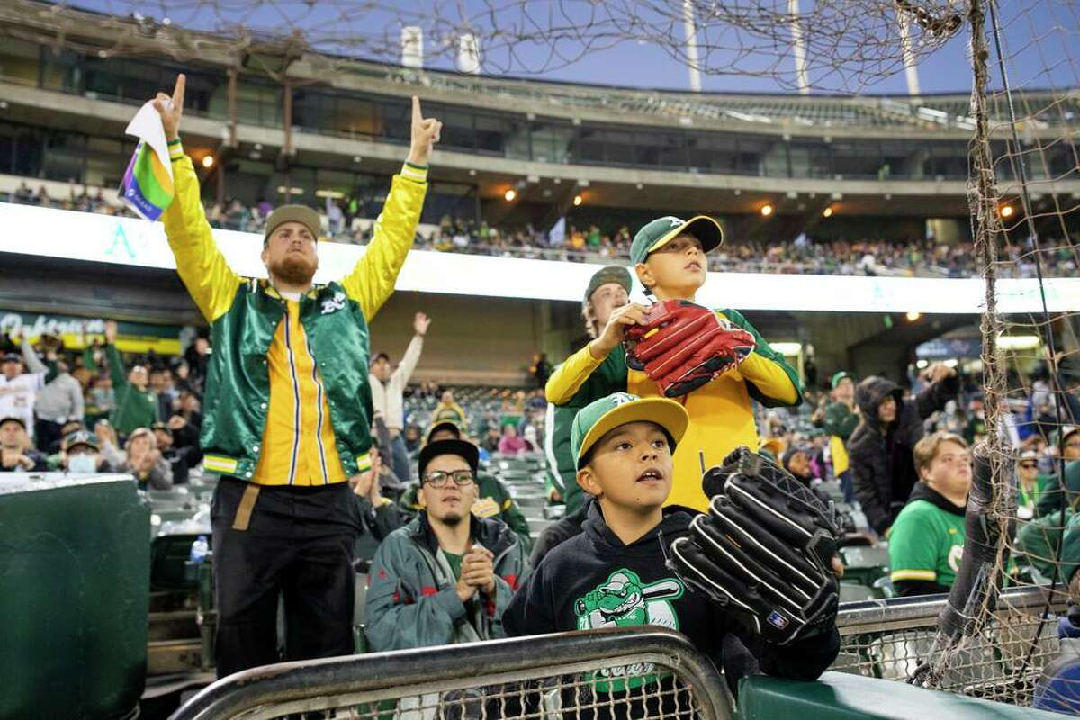 From left: James Park, Rafael Bernstein, eight-year-old Alexander De Leon and 10-year-old Jonathan Catano, 10, react during the MLB game between the Oakland Athletics and the Cleveland Indians at RingCentral Coliseum, Friday, July 16, 2021, in Oakland, Calif.