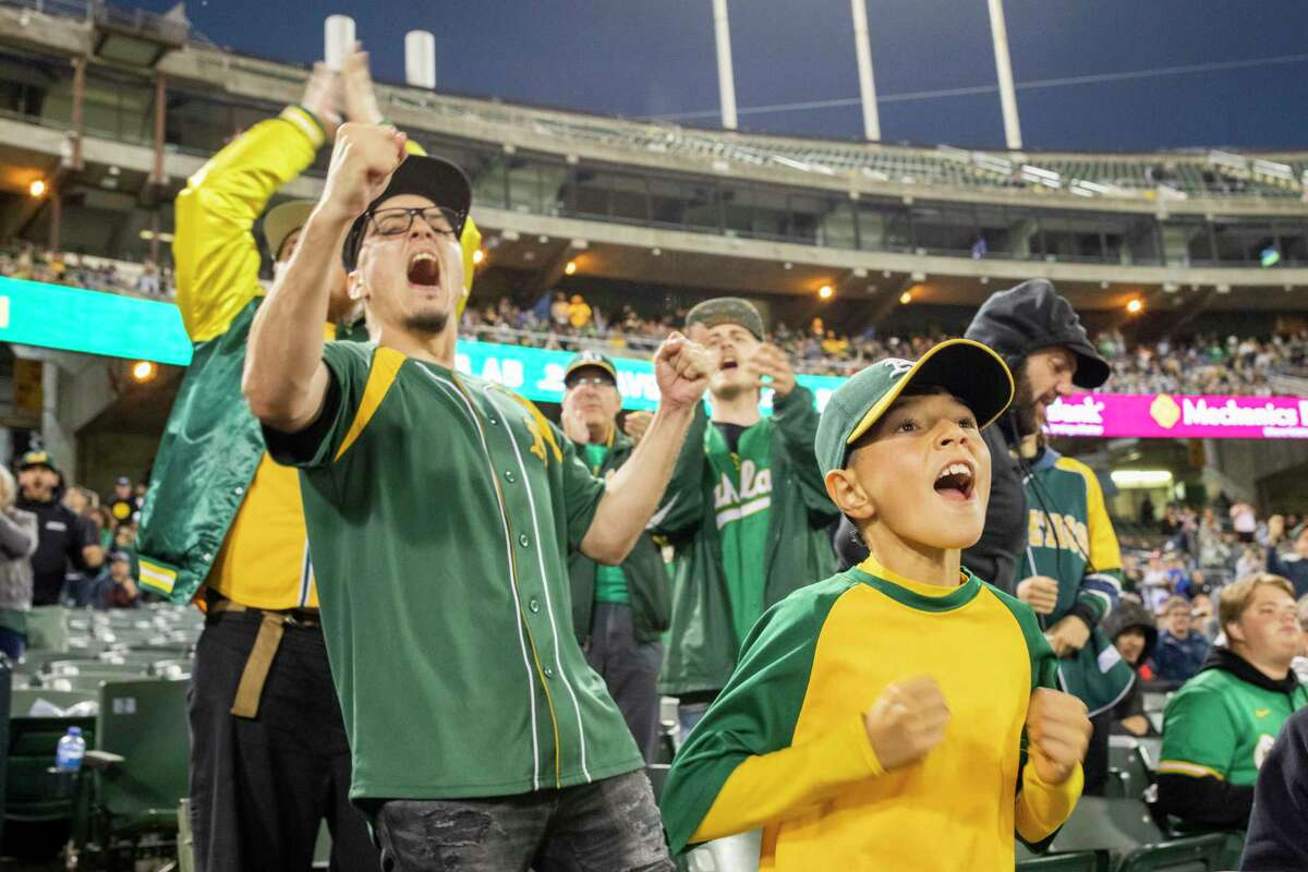 10-year-old Jonathan Catano (front) cheers as the Oakland Athletics take on the Cleveland Indians at RingCentral Coliseum on Friday.