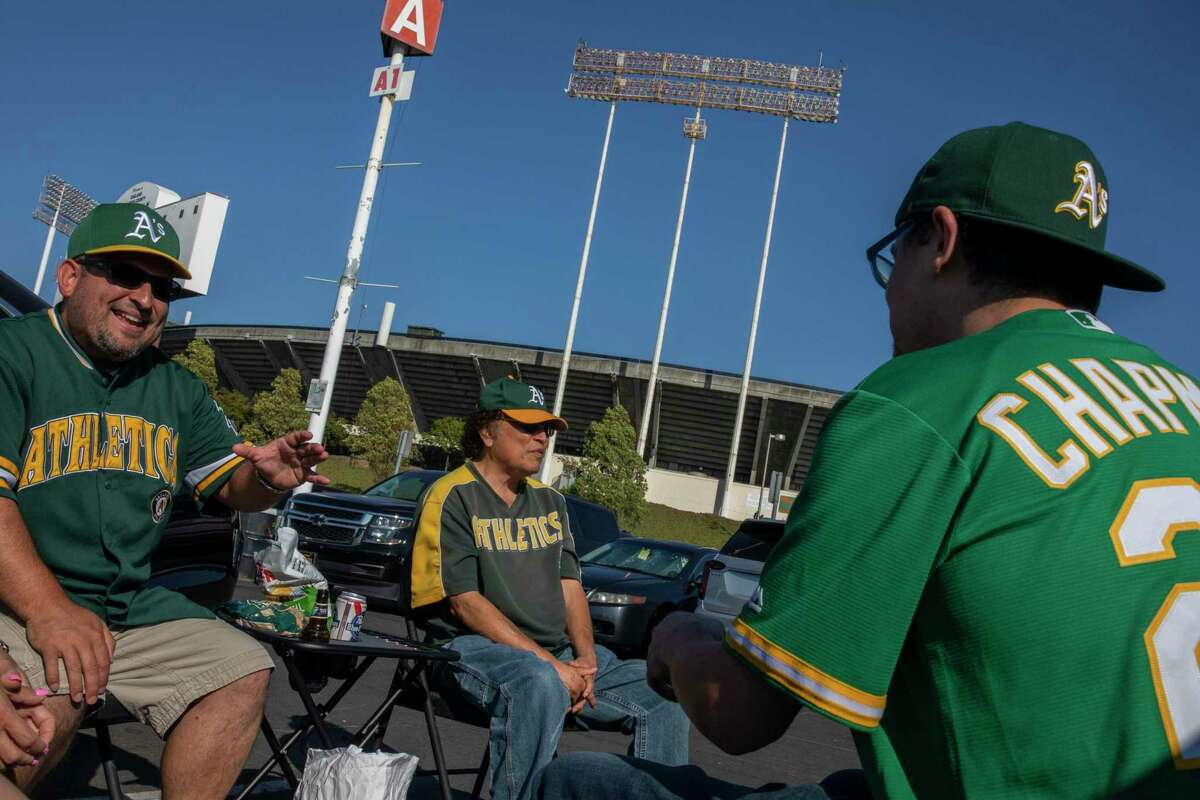 Jose Castellanoz Jr., Jose Castellanoz and Arcadio Castellanoz Jr. talk outside Oakland Coliseum before going in to see the A's take on Cleveland.