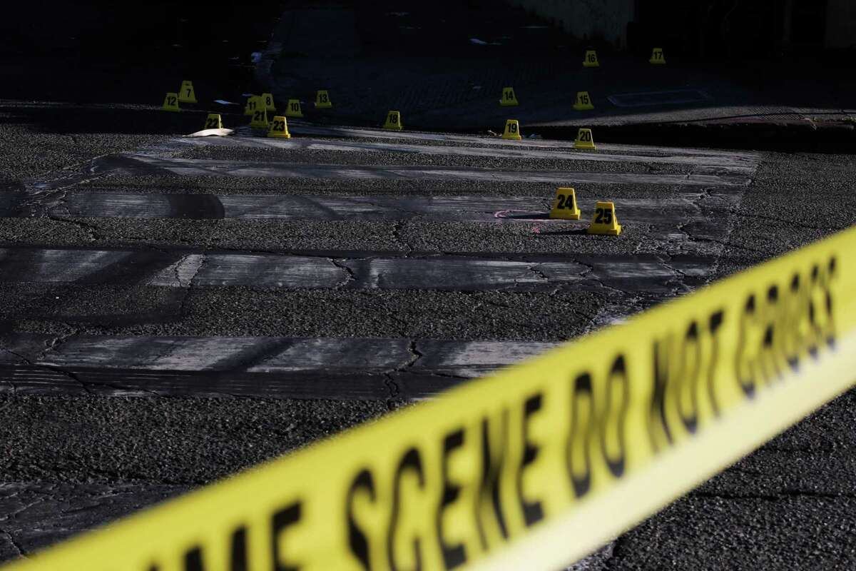 Evidence markers and tape at the scene of a shooting last month in Oakland, one of many U.S. cities that have seen murders increase since 2019.