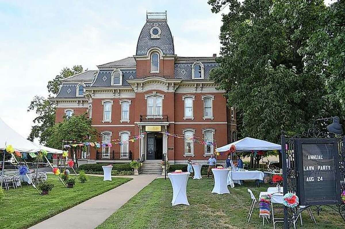 The Art Association of Jacksonville's David Strawn Art Gallery at 331 W. College St. is decorated in August 2019 for the association's annual Lawn Party.