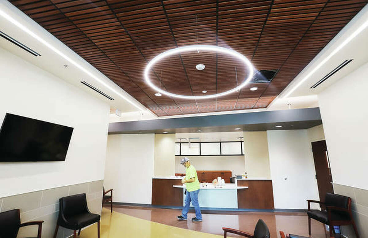 A worker passes through the lobby of the SIU School of Dental Medicine's new Advanced Care Clinic in Alton this week. Work began on the $11.5 million project in April 2020. Contractors were hoping to be out of the building by the end of work Friday. SIU is expected to have students in the facility by Aug. 1.