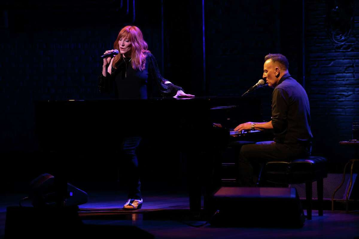 """Bruce Springsteen performs with his wife, Patti Scialfa, in """"Springsteen on Broadway."""""""