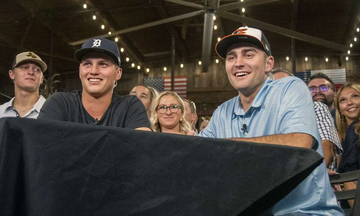 Cypress Ranch High School 2018 graduates Ty Madden, seated left, and Colton Cowser, seated right, were selected on the first day of the 2021 Major League Baseball First-Year Player draft. Cowser was selected fifth overall by the Baltimore Orioles, while Madden was picked 32nd overall by the Detroit Tigers.