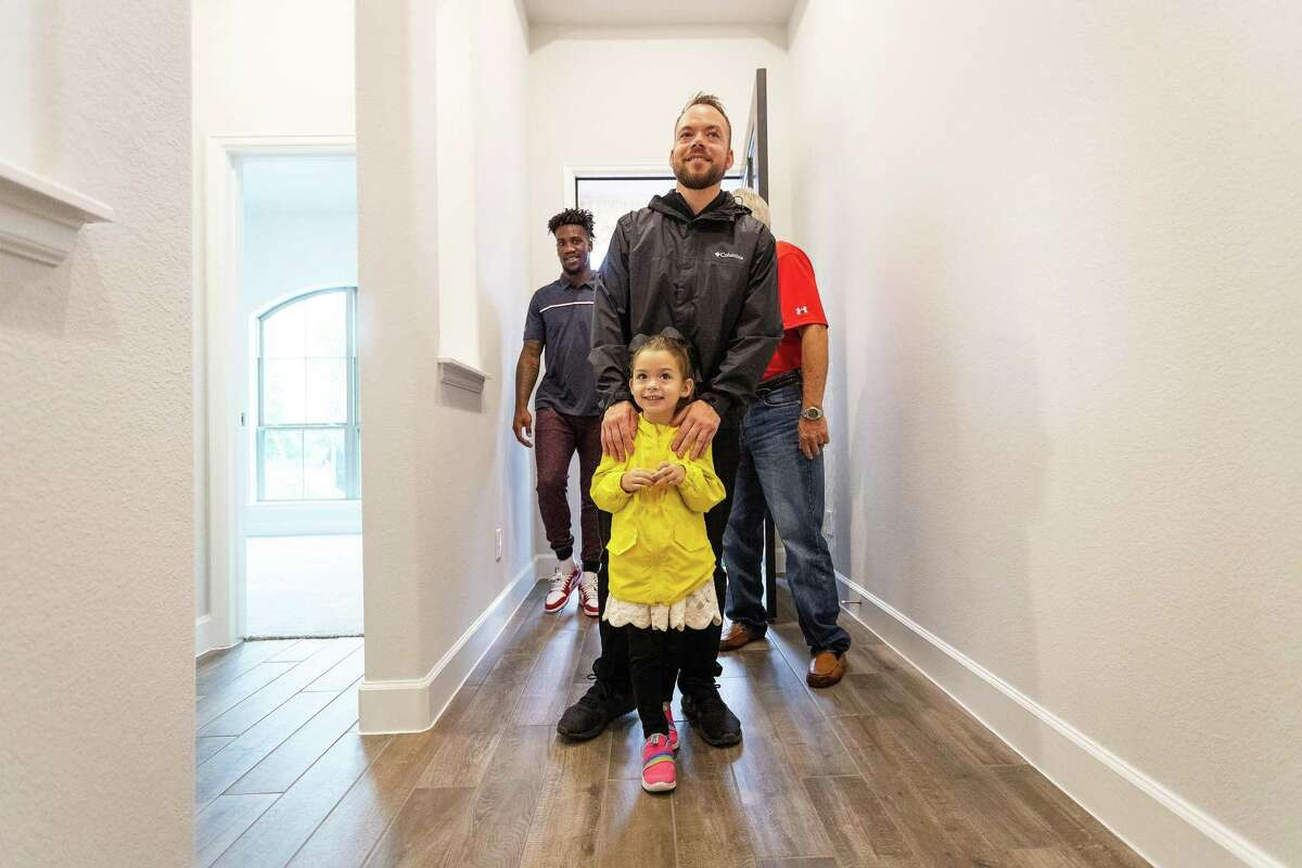 SSG Stephen Netzley and his daughter Mrazy were greeted by a host of cameras when they walked into their new mortgage-free home courtesy of Operation FINALLY Home and their partners.