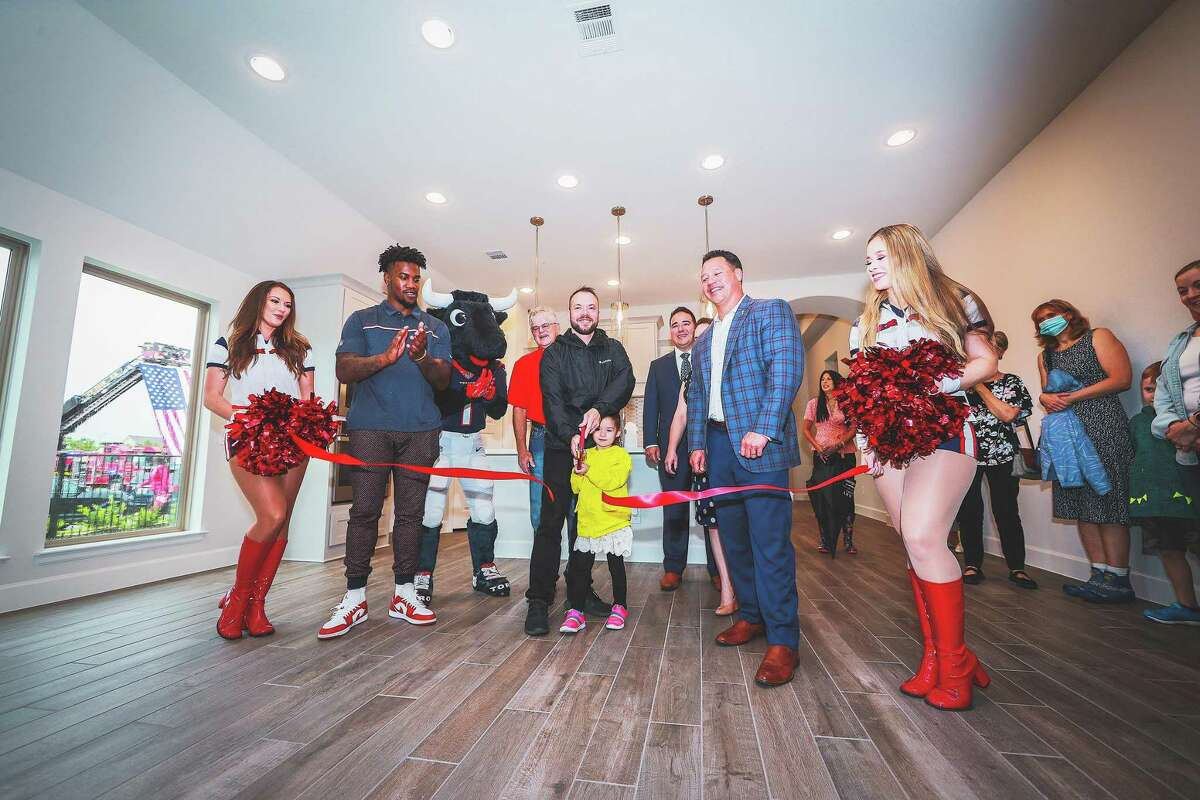 The ribbon cutting ceremony was held inside the home to avoid the rain. Netzley and his daughter Mrazy were excited to see their new home.