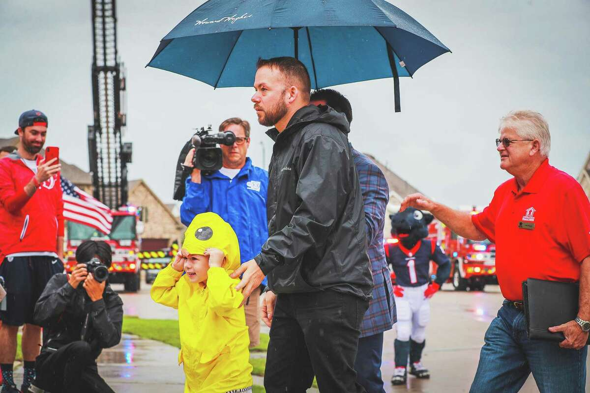 SSG Stephen Netzley and his daughter Mrazy get an escort into their new home. Despite the rain, nothing could dampen the spirit of the community and stakeholders at the dedication.