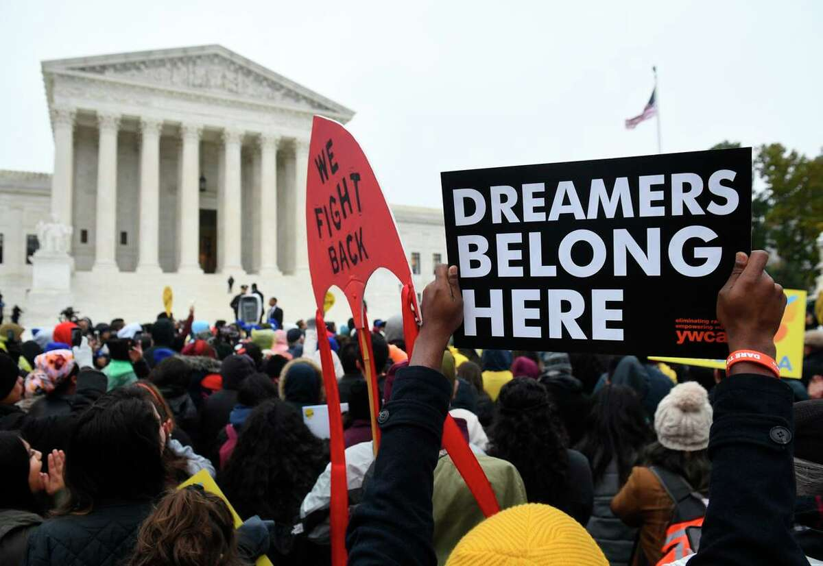 Immigration rights activists rally outside the U.S. Supreme Court in 2019. A federal judge has dealt a fresh blow to an immigration program protecting undocumented immigrants brought to the country as children, ruling it unlawful and blocking the enrollment of new applicants.