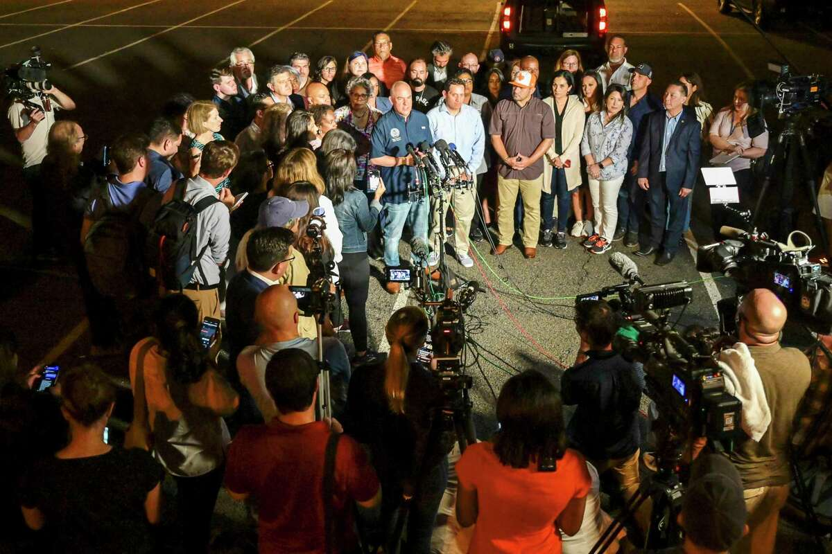 Texas House Democrats speak to reporters on July 12 after arriving at Dulles International Airport from Austin in a second high-profile effort to block Republican legislation on voting laws. MUST CREDIT: photo for The Washington Post by Craig Hudson.