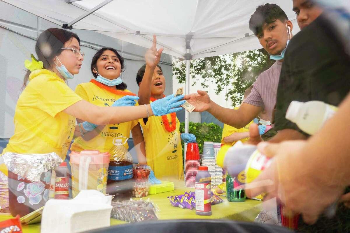 (LtoR) Jasmine Canaca, 13, Jocelyn Rodriguez, 13, and Kendrick Tatum, 12 sell lemonade outside of the John and Cissy Harvard Boys and Girls Club of Greater Houston on Friday, July 16, 2021.
