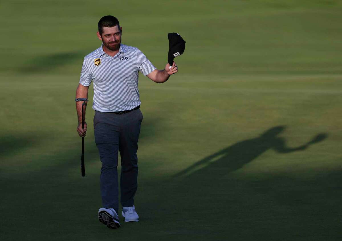 South Africa's Louis Oosthuizen acknowledges the crowd as he walks from the 18th green after completing his third round at the British Open Golf Championship at Royal St George's golf course Sandwich, England, Saturday, July 17, 2021. (AP Photo/Ian Walton)