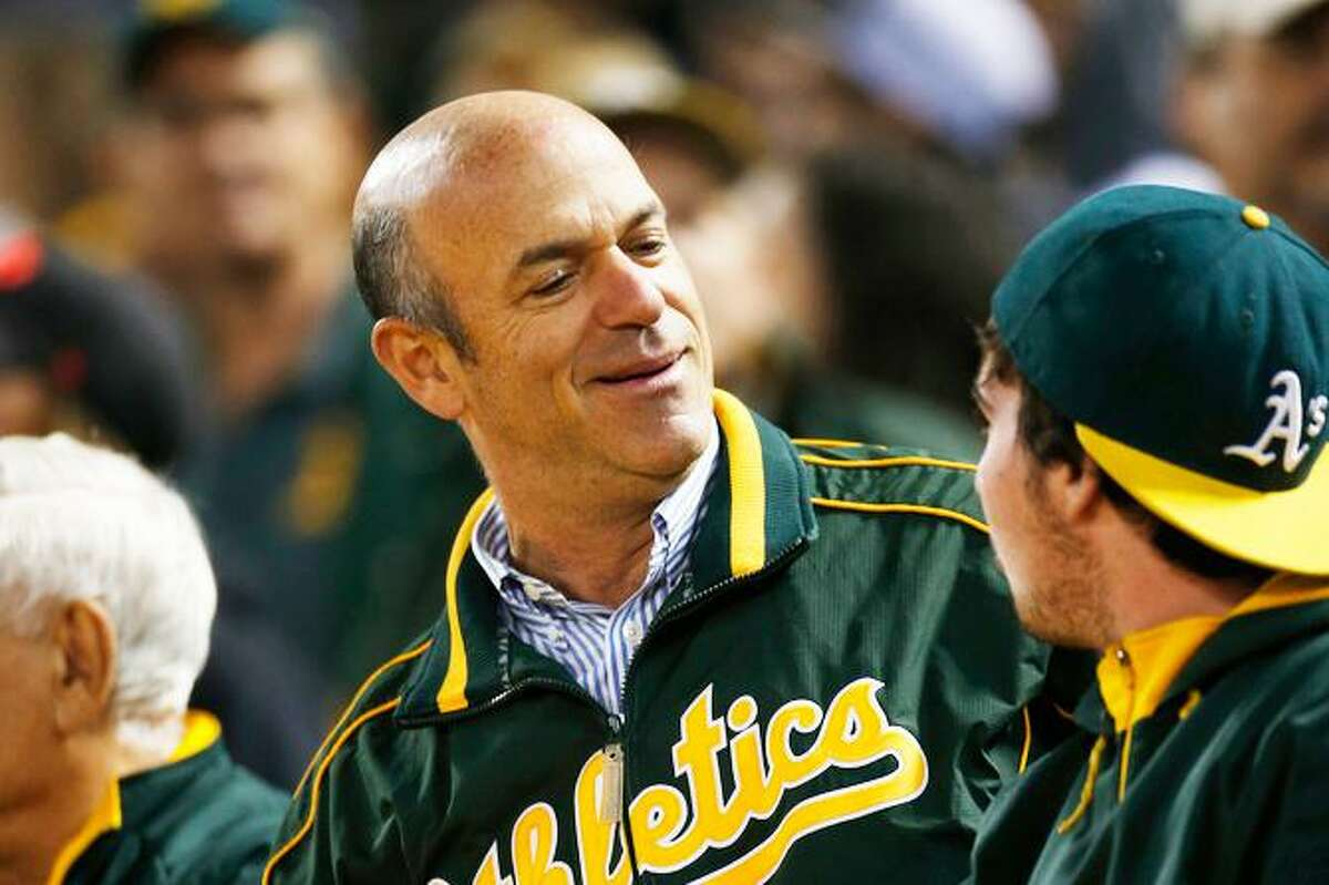 A's owner John Fisher, at a 2016 home game, has let sidekick Dave Kaval and Commissioner Rob Manfred do his talking.