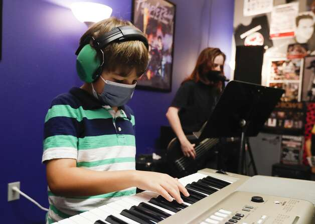 Daniel Stavar plays the keyboard during School of Rock's Rock 101 camp, Wednesday, July 14, 2021, in The Woodlands. Campers ages 7-12 explored instruments through musical games and activities during the five-game experience that ends with a concert on Friday. Photo: Jason Fochtman/Staff Photographer / 2021 © Houston Chronicle