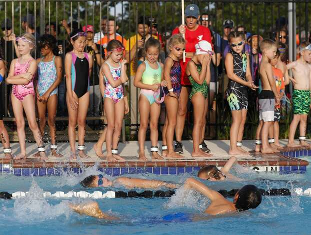 Kids wait to take their turn in the swimming portion of the YMCA Kids Triathlon at The Woodlands Family YMCA at Branch Crossing, Saturday, July 17, 2021, in The Woodlands. Photo: Jason Fochtman/Staff Photographer / 2021 © Houston Chronicle