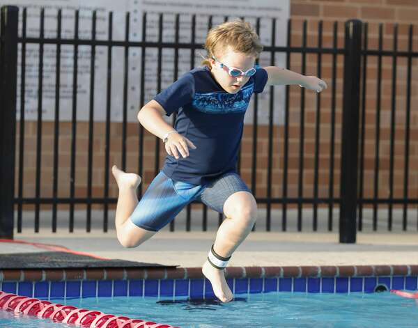 Nolan Gunnell jumps into the pool as nearly 300 kids compete in the YMCA Kids Triathlon at The Woodlands Family YMCA at Branch Crossing, Saturday, July 17, 2021, in The Woodlands. Photo: Jason Fochtman/Staff Photographer / 2021 © Houston Chronicle