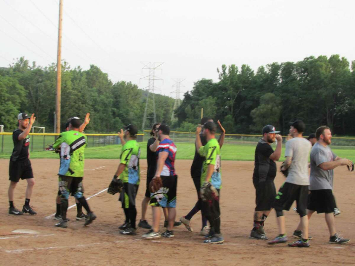 Players from Benchwarmers 2.0 and Aldredo's and Jimmy's Meatballers wrap up the first of four games in the Torrington Parks and Recreation Softball League Thursday evening at Toro Park.