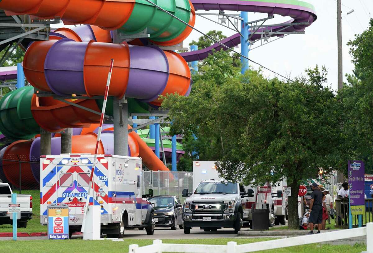 Emergency personnel are shown on scene where people are being treated after chemical leak at Six Flags Hurricane Harbor Splashtown Saturday, July 17, 2021 in Spring.