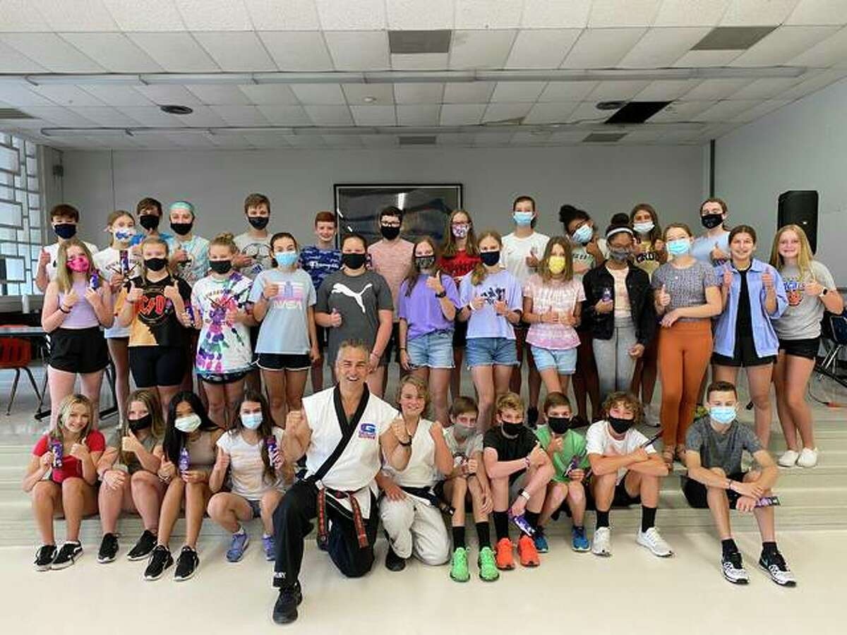 Senior Master Instructor Rich Grogan with G.O. campers on Thursday. Some masks were removed for the purpose of the photo.