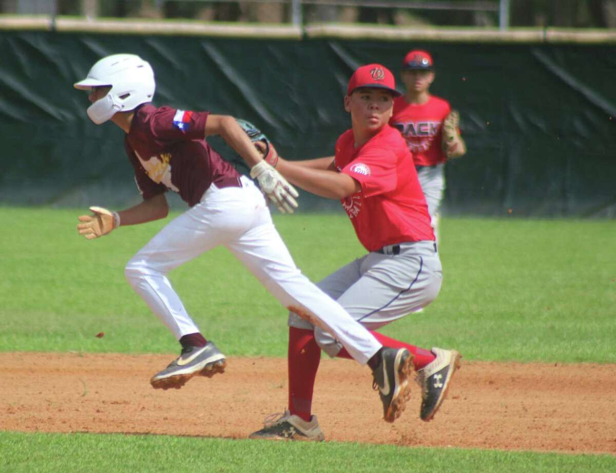 Deer Park's Daniel Rivera gets tagged out, ending a rundown in the second inning during Saturday's South Zone championship game for the 13s.