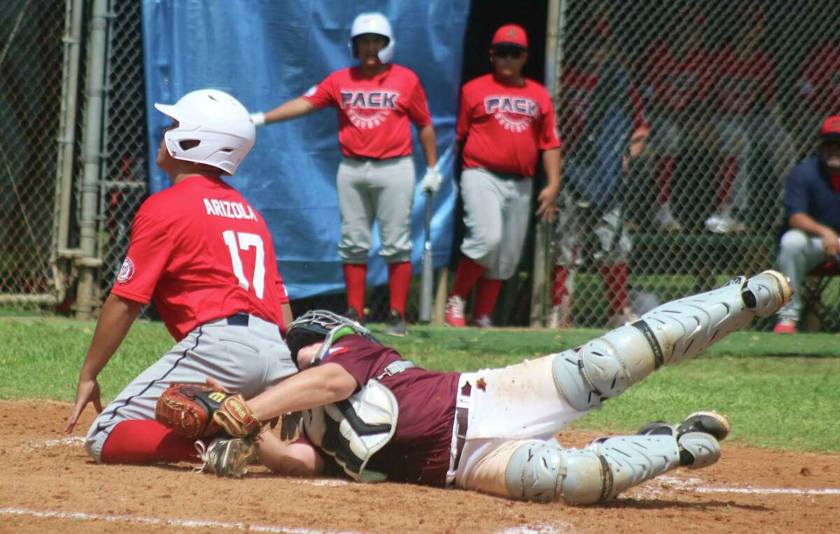 Deer Park catcher Cayden Weber is unable to apply the tag on time on Alamo City's Andrew Arizola during fourth-inning action Saturday in the South Zone championship game at Bay Area Park.