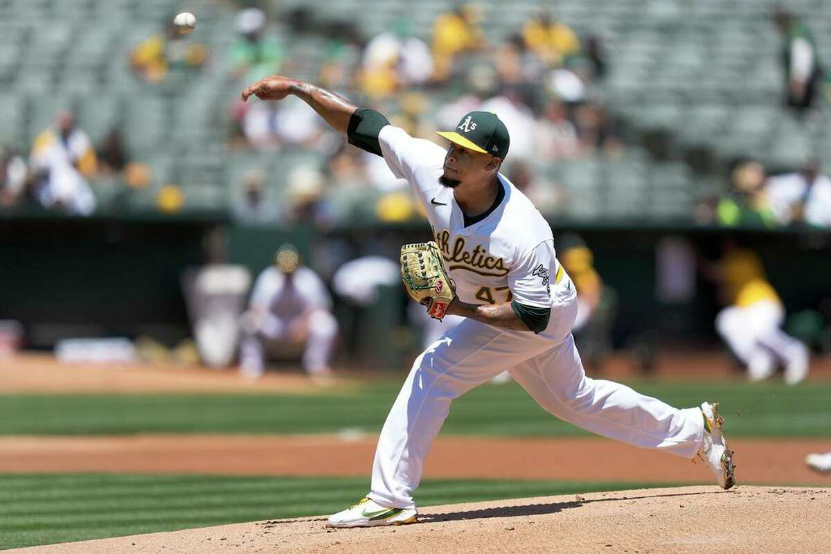 Oakland Athletics starting pitcher Frankie Montas throws against the Cleveland Indians during the first inning of a baseball game Saturday, July 17, 2021, in Oakland, Calif. (AP Photo/Tony Avelar)