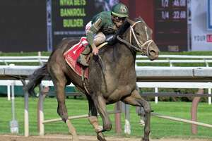 Wit ridden by Irad Ortiz Jr. wins The Sanford Stakes at the Saratoga Race Course Saturday July 17, 2021 in Saratoga Springs, N.Y. Photo Special to the Times Union by Skip Dickstein