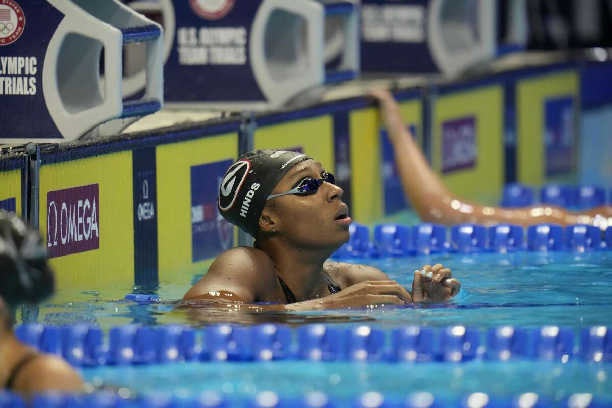 Natalie Hinds after swimming in the women's 50 freestyle during wave 2 of the U.S. Olympic Swim Trials on Saturday, June 19, 2021, in Omaha, Neb. (AP Photo/Jeff Roberson)