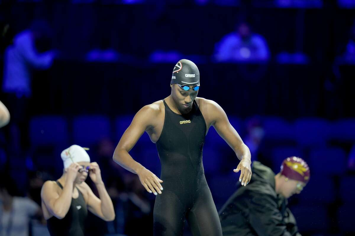 Natalie Hinds participates in the women's 100 freestyle during wave 2 of the U.S. Olympic Swim Trials on Friday, June 18, 2021, in Omaha, Neb. (AP Photo/Jeff Roberson)