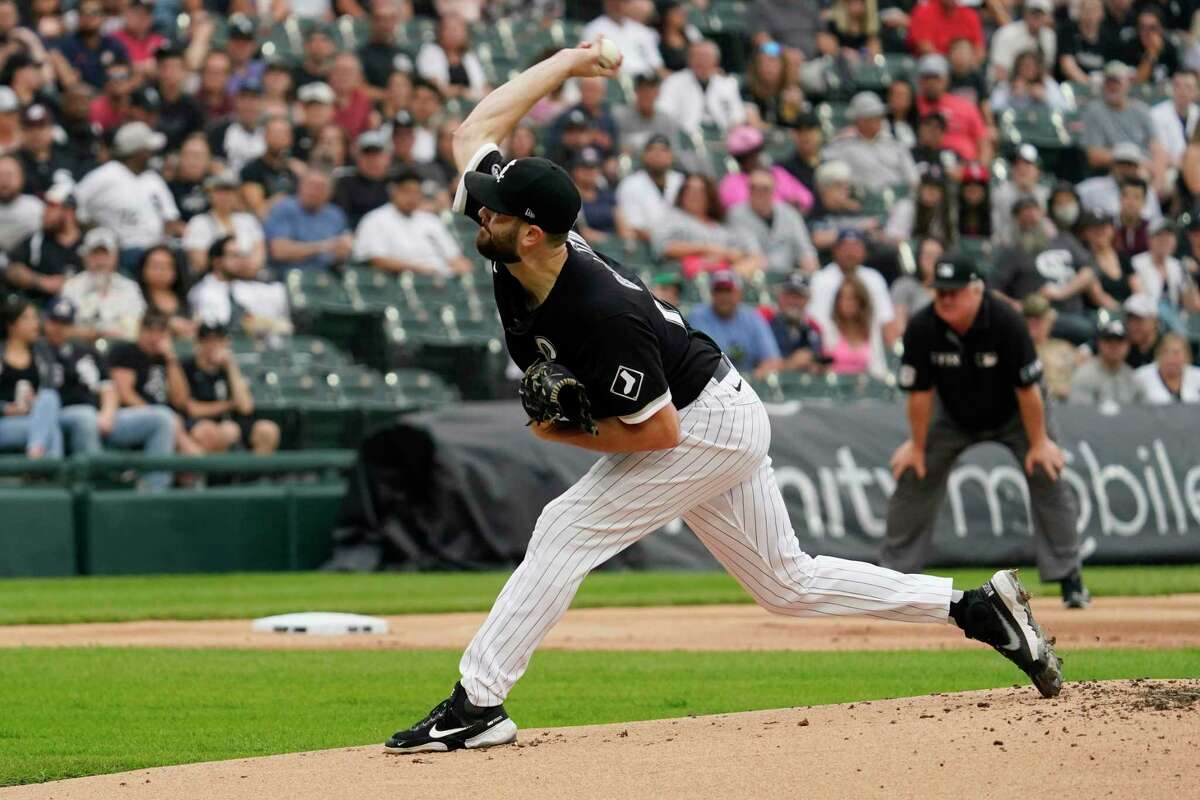 Chicago White Sox starting pitcher Lucas Giolito throws against the Houston Astros during the first inning of a baseball game in Chicago, Saturday, July 17, 2021. (AP Photo/Nam Y. Huh)