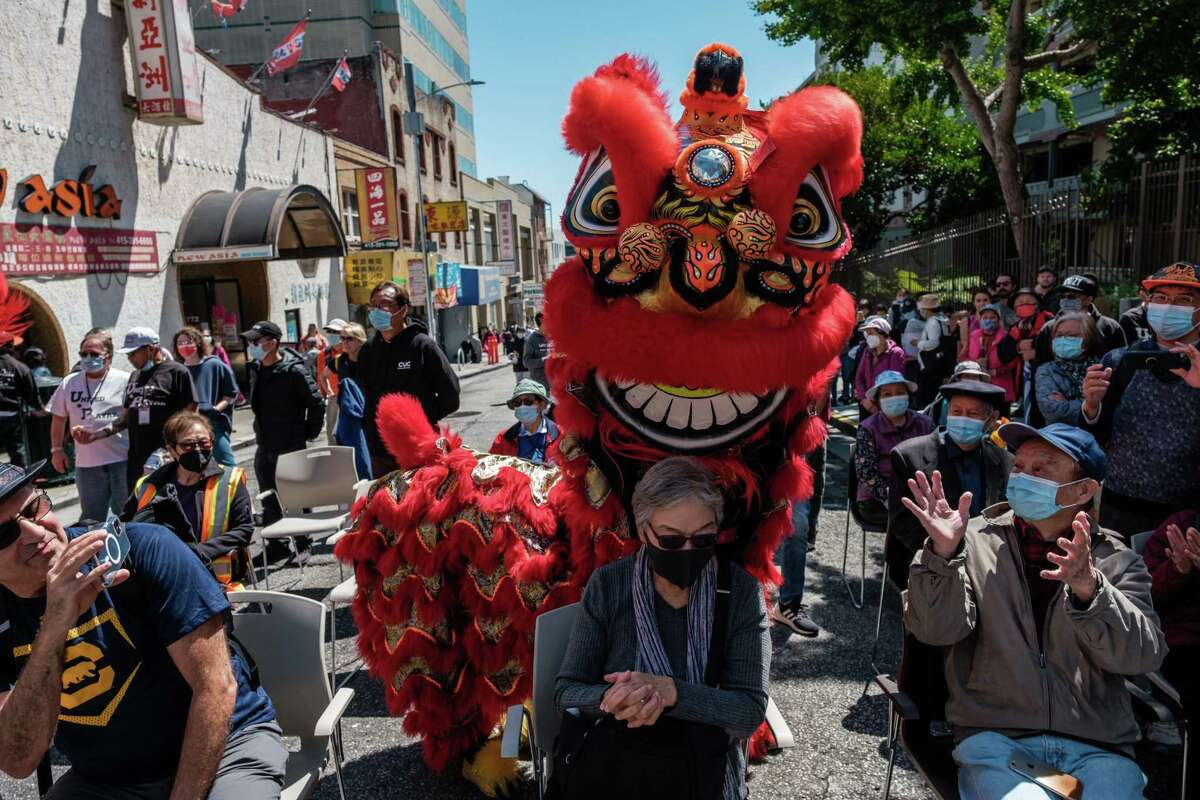 CYC Dancers perform a Lion Dance at a Summer block party at Ping Yuen public housing project in the heart of San Francisco's Chinatown.
