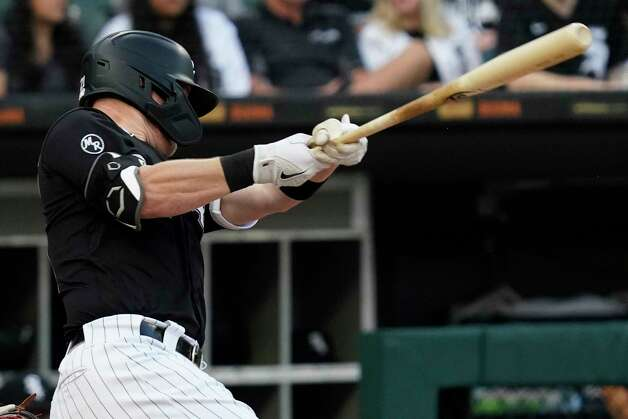 Chicago White Sox's Zack Collins follows through on a solo home run during the third inning of the team's baseball game against the Houston Astros in Chicago, Saturday, July 17, 2021. (AP Photo/Nam Y. Huh) Photo: Nam Y. Huh, Associated Press / Copyright 2021 The Associated Press. All rights reserved.