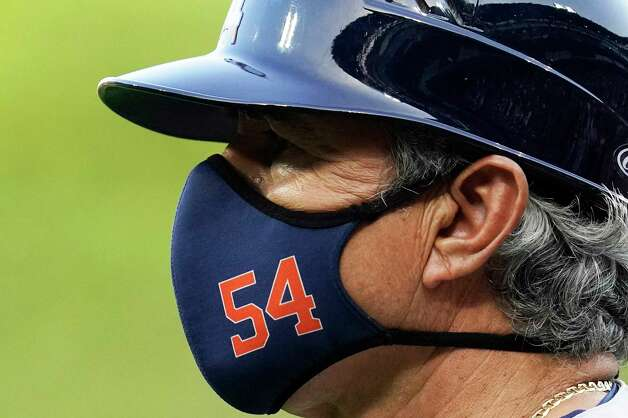 Houston Astros first base coach Dan Firova watches his team during the second inning of a baseball game against the Chicago White Sox in Chicago, Saturday, July 17, 2021. (AP Photo/Nam Y. Huh) Photo: Nam Y. Huh, Associated Press / Copyright 2021 The Associated Press. All rights reserved.
