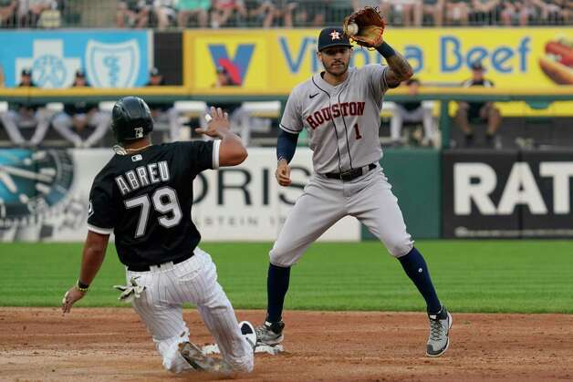Houston Astros shortstop Carlos Correa, right, forces out Chicago White Sox's Jose Abreu at second during the third inning of a baseball game in Chicago, Saturday, July 17, 2021. (AP Photo/Nam Y. Huh) Photo: Nam Y. Huh, Associated Press / Copyright 2021 The Associated Press. All rights reserved.