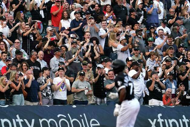 Chicago White Sox fans celebrate after Tim Anderson hitting a solo home run during the third inning of the team's baseball game against the Houston Astros in Chicago, Saturday, July 17, 2021. (AP Photo/Nam Y. Huh) Photo: Nam Y. Huh, Associated Press / Copyright 2021 The Associated Press. All rights reserved.