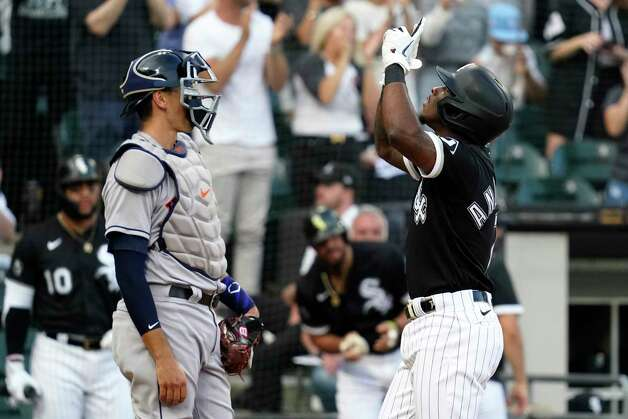 Chicago White Sox's Tim Anderson, right, celebrates his solo home run next to Houston Astros catcher Jason Castro during the third inning of a baseball game in Chicago, Saturday, July 17, 2021. (AP Photo/Nam Y. Huh) Photo: Nam Y. Huh, Associated Press / Copyright 2021 The Associated Press. All rights reserved.