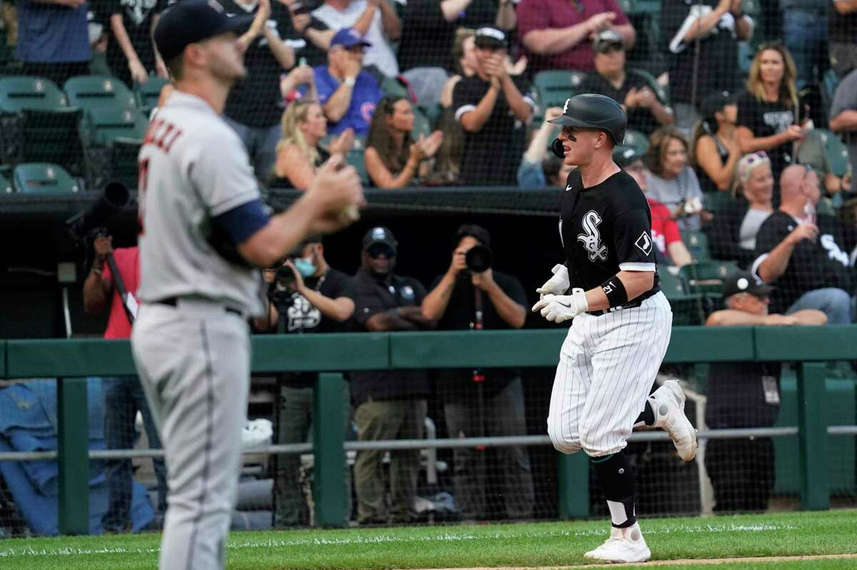 Chicago White Sox's Zack Collins runs the bases after hitting a solo home run during the third inning of the team's baseball game against the Houston Astros in Chicago, Saturday, July 17, 2021. (AP Photo/Nam Y. Huh)