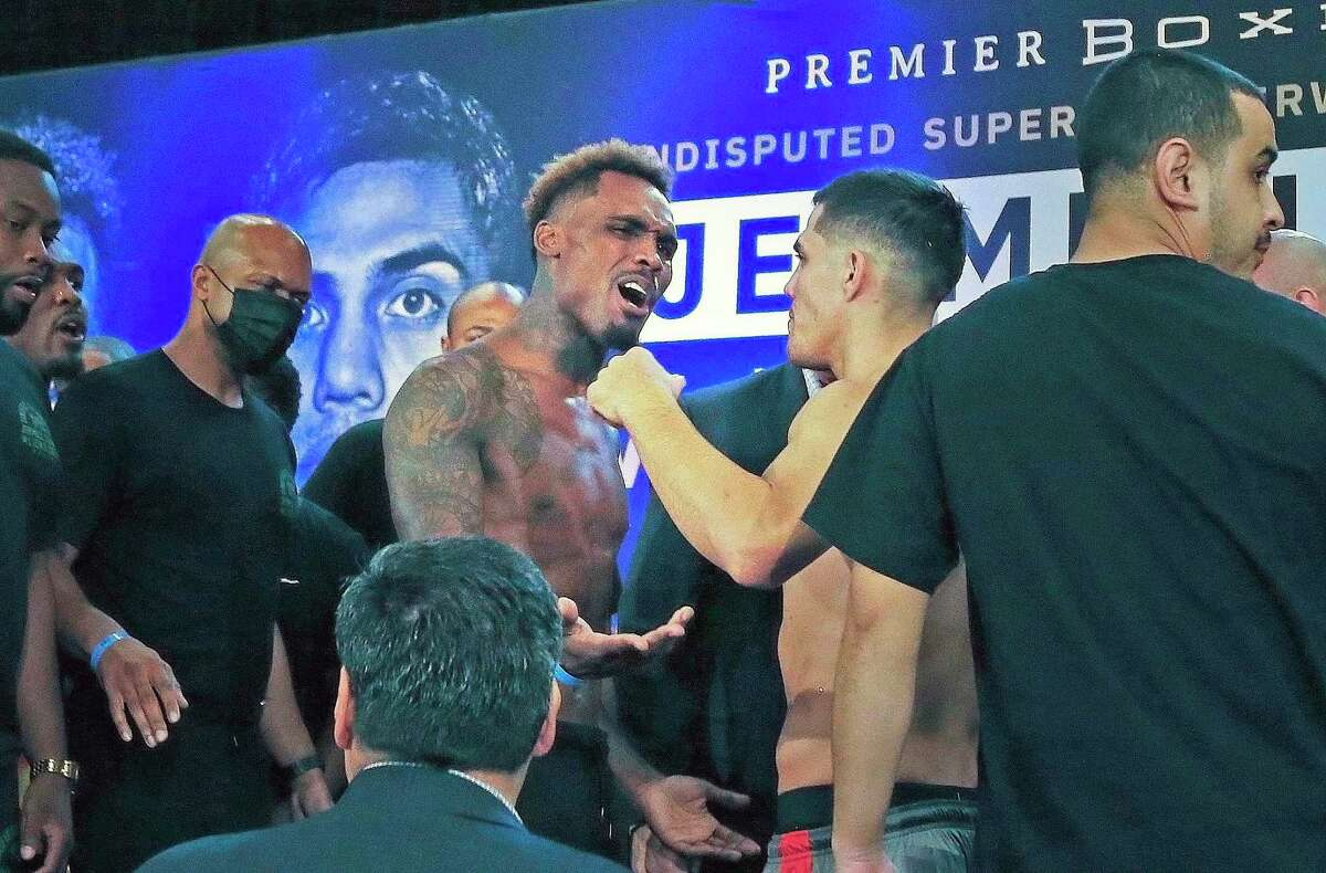 Jermell Charlo,L, and Brian Castano get into a little bit of bravado before the stare down photos. The official weigh-in for this weekend's undisputed 154-pound championship boxing bout between Jermell Charlo and Brian Castano at the Thompson San Antonio - Riverwalk hotel on Friday, July 16, 2021 at